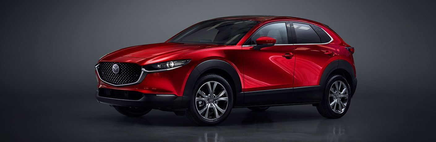 The front and side image of a red 2020 Mazda CX-30.