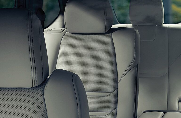 The interior view of the rear seating inside a 2020 Mazda CX-9.