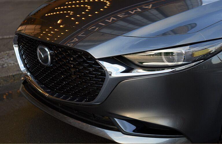 The front bumper of a gray 2021 Mazda3 Sedan.