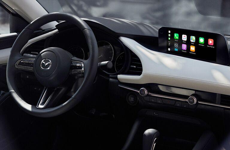 The front interior inside the 2021 Mazda3 Sedan.
