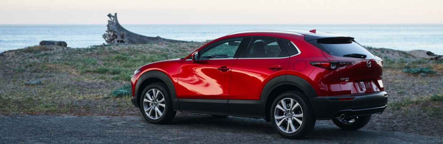 The rear and side view of a red 2021 Mazda CX-30 2.5 S.