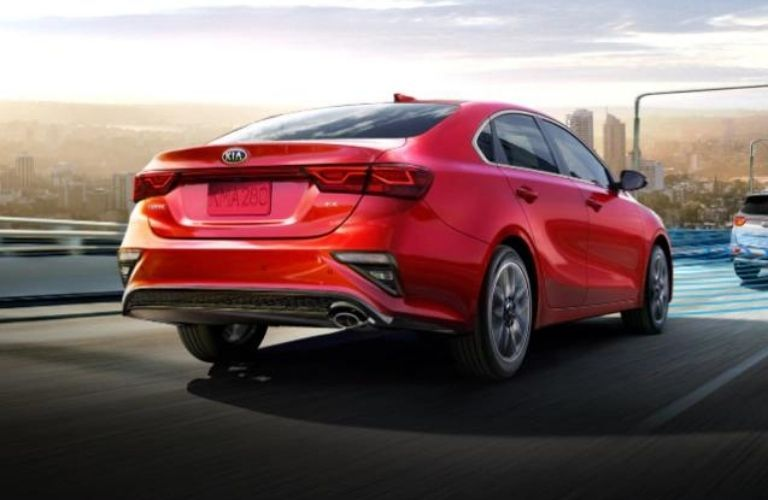 2021 Kia Forte Red driving on the road