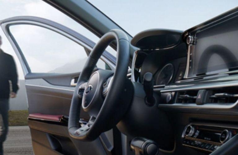 2021 Kia K5 interior dash and wheel