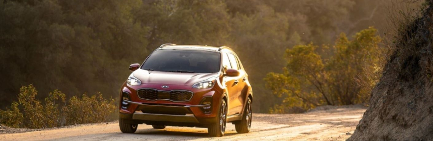 2021 Kia Sportage parked outside at sunset