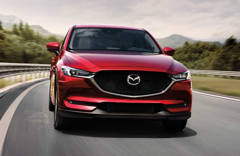Red 2017 Mazda CX-5 Driving on a Mountainous Highway