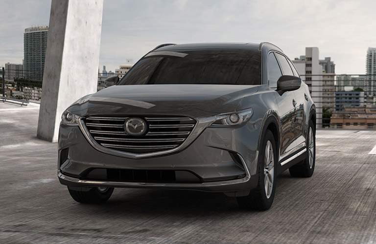 silver 2018 mazda cx-9 front grille parked on parking garage roof
