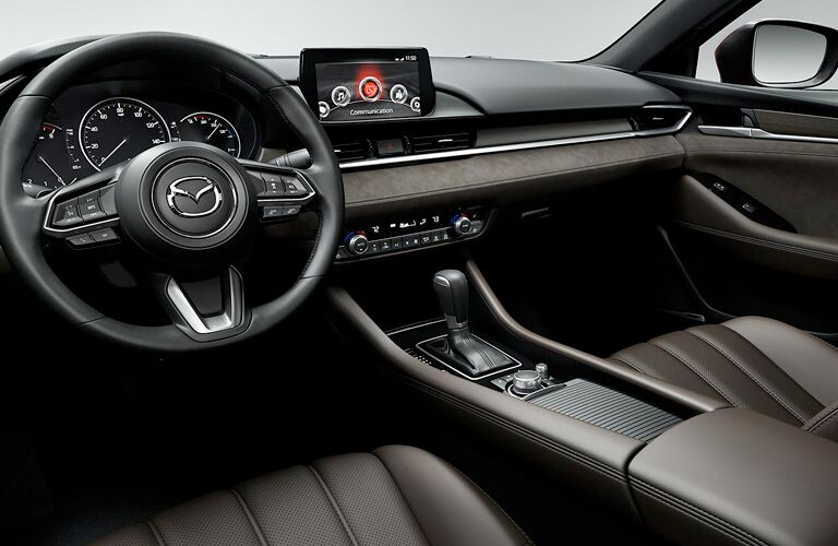 front interior of 2018 mazda6 including steering wheel, seats and center infotainment interface