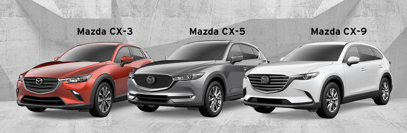 Red 2019 Mazda CX-3 vs Gray 2019 Mazda CX-5 vs White 2019 Mazda CX-9 on Gray Background with Black Model Names Above