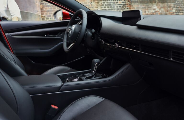 Interior view of the front seating area inside a 2019 Mazda3 Hatchback