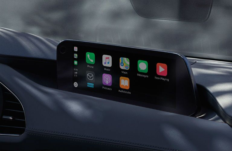Interior view of Apple CarPlay on the touchscreen display inside a 2019 Mazda3 Hatchback