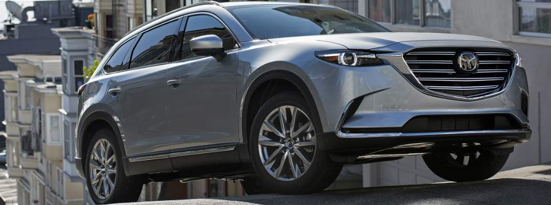 2018 silver mazda cx-9 scaling steep road in san francisco