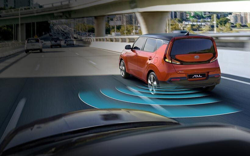 Illustrated image of a 2020 Kia Soul's blind-spot collision warning system in action