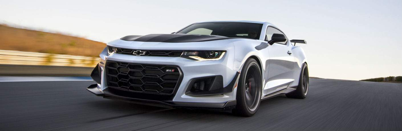 2018 chevrolet camaro in white driving on track