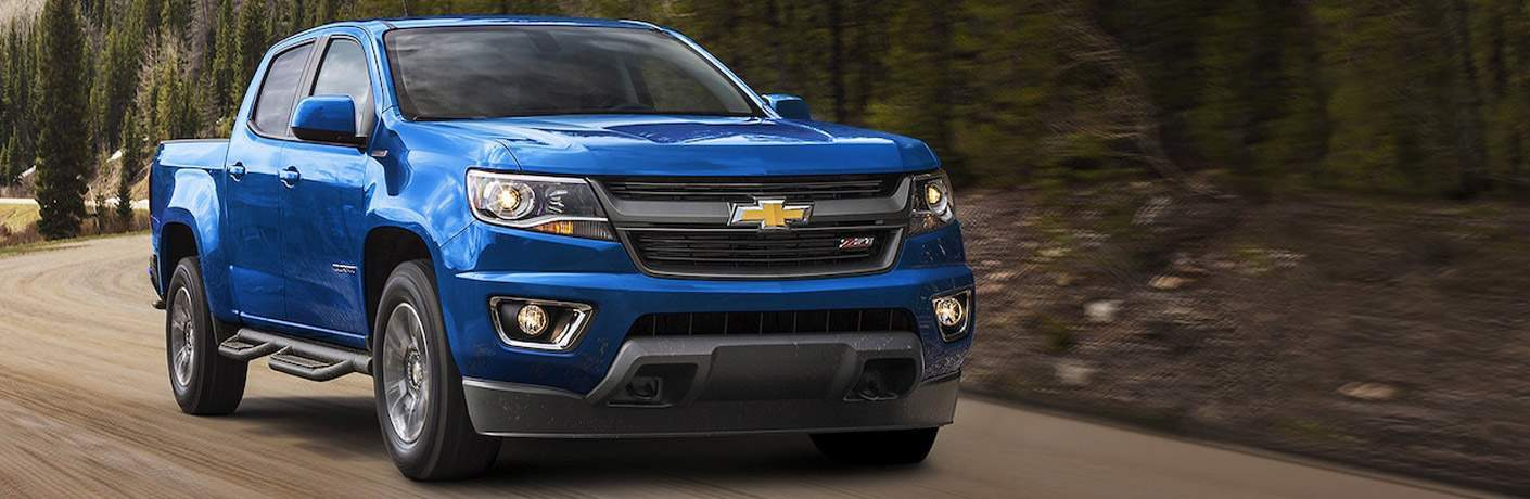 2018 chevrolet colorado shown in z71 trim in blue color driving on forest road