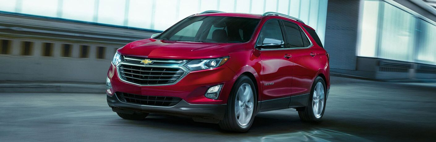 2018 chevy equinox in stylish red cruising through urban street