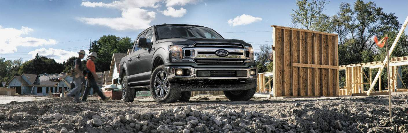 2018 ford f-150 at home building job site in gray brown color 2/3 view from front with construction workers behind
