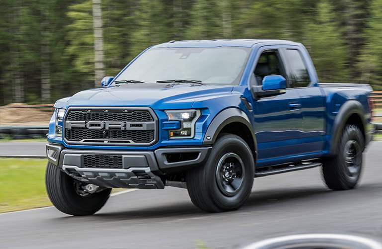 2018 ford f-150 raptor shown on road in blue color with large wheel arches and bfgoodrich tires