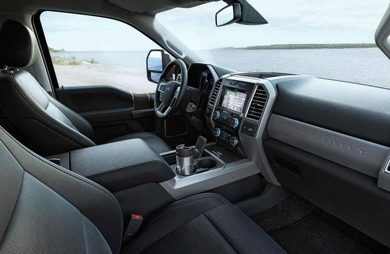Interior of 2018 ford f-250 super duty showing infotainment steering wheel and seating