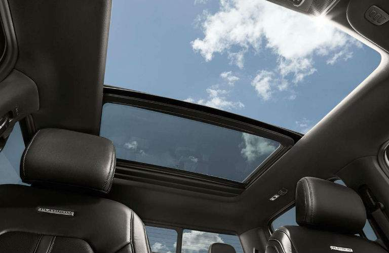 twin moonroof in 2018 ford f-150 platinum shown from underneath looking up through panoramic opening