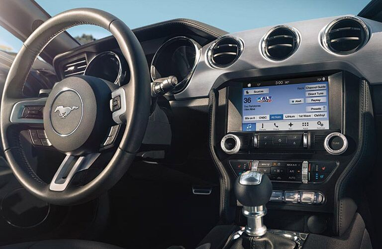 2017 Ford Mustang interior with steering wheel and infotainment system