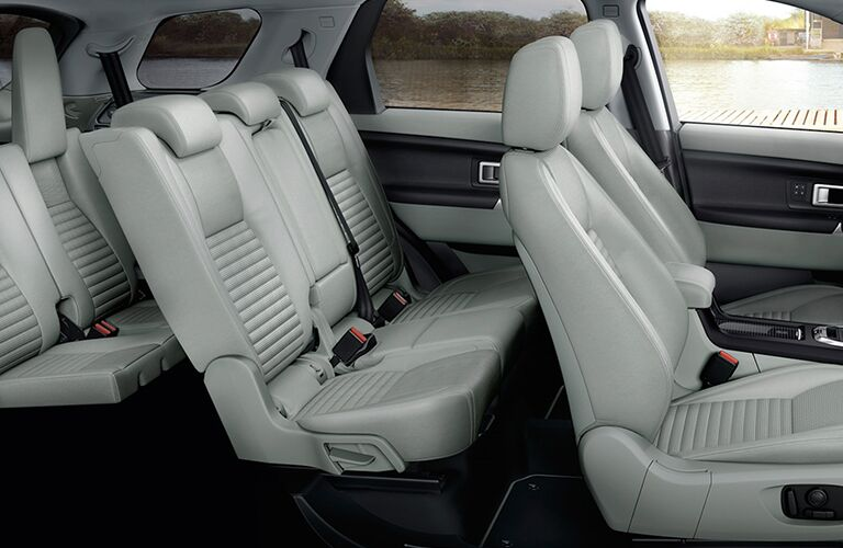 2018 Land Rover Discovery Sport three rows of tan seats