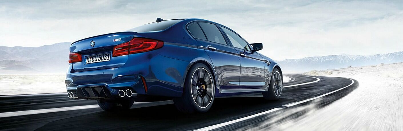 2018 BMW M5 blue side back view