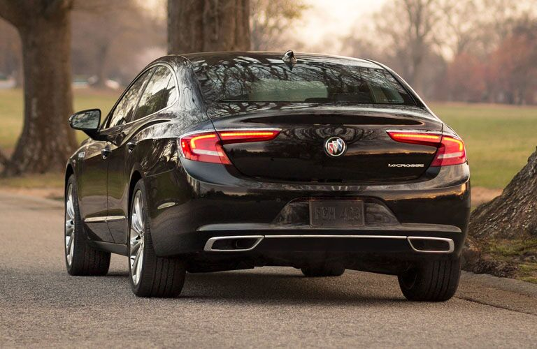 Rear shot of black 2019 Buick LaCrosse parked in front of trees