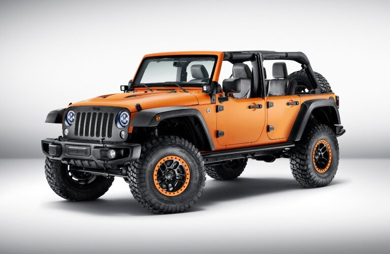 Lifted custom Jeep Wrangler orange side view