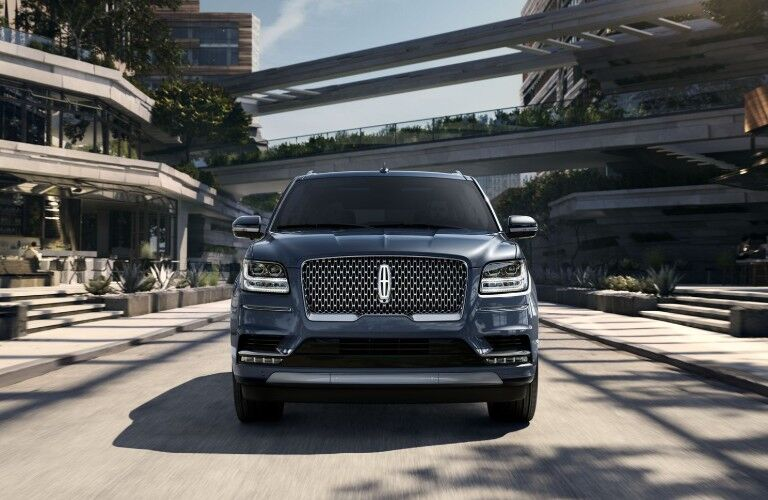 Front view of 2019 Lincoln Navigator driving through city