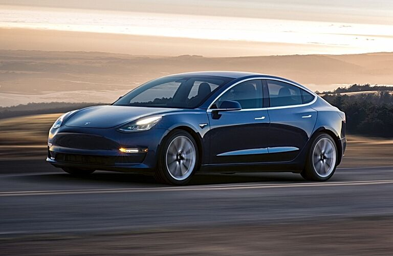 Tesla Model 3 blue side view