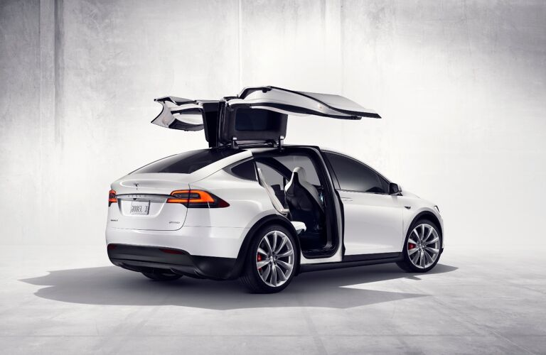 Tesla Model X white back view doors open
