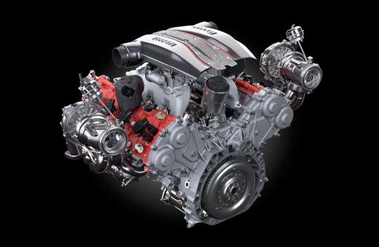 ferrari engine on black background