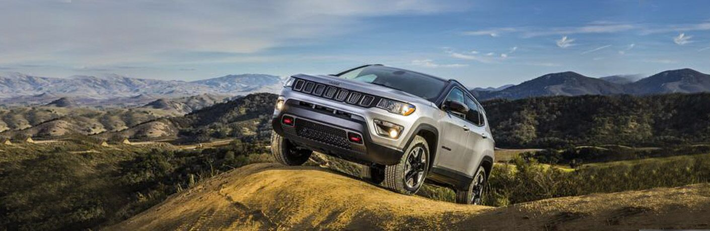 Front exterior view of a gray 2018 Jeep Compass