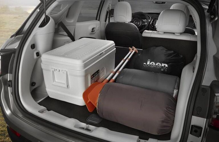 Rear cargo area of the 2018 Jeep Compass filled with cargo