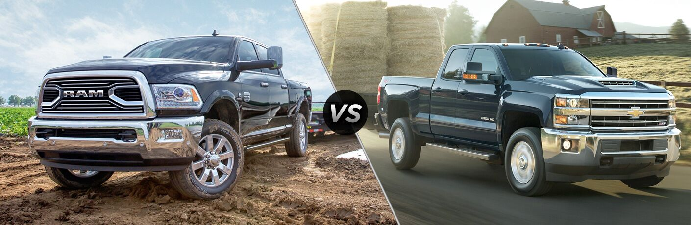 """Front exterior view of a black 2018 Ram 2500 on the left """"vs"""" front exterior view of a black 2018 Chevy Silverado 2500 on the right"""