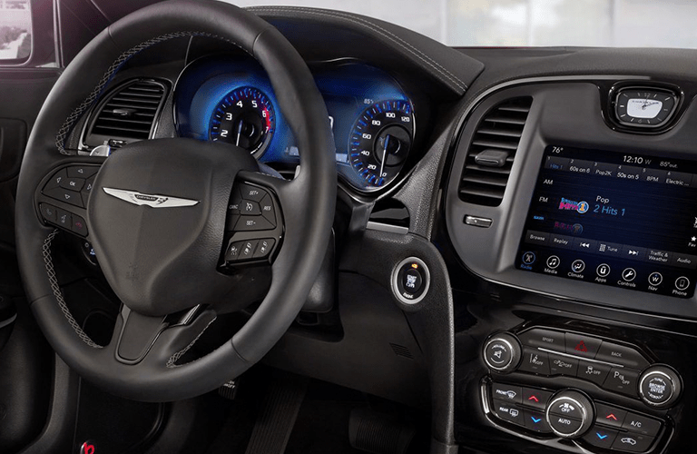 Steering wheel, gauges, and touchscreen in 2019 Chrysler 300