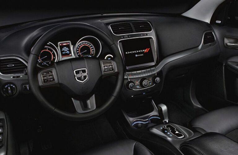 Steering wheel, gauges, and touchscreen in 2019 Dodge Journey