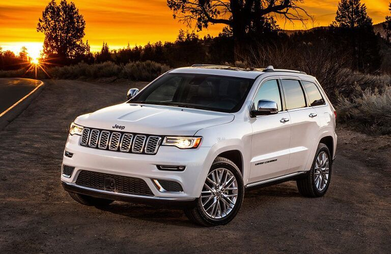 Front driver side exterior view of a white 2019 Jeep Grand Cherokee