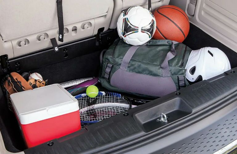 Rear cargo area of the 2019 Dodge Grand Caravan filled with sports gear