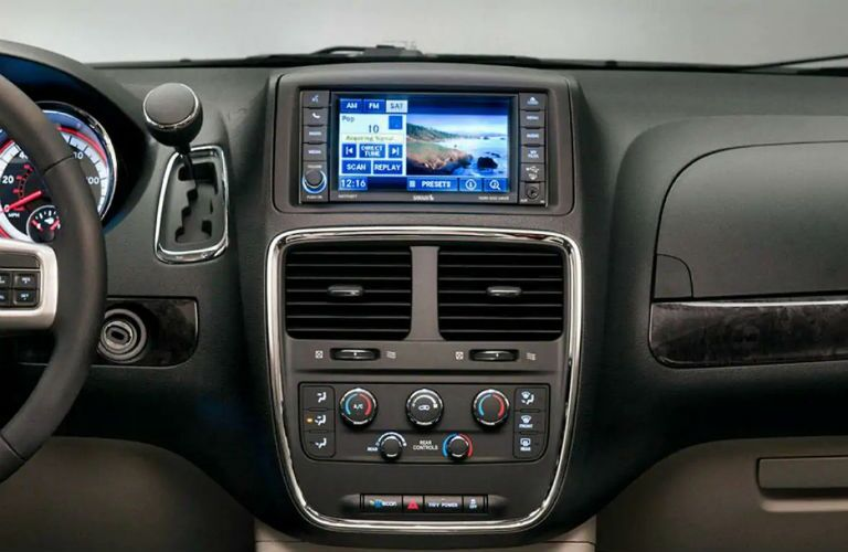 Touchscreen display and temperature controls of the 2019 Dodge Grand Caravan