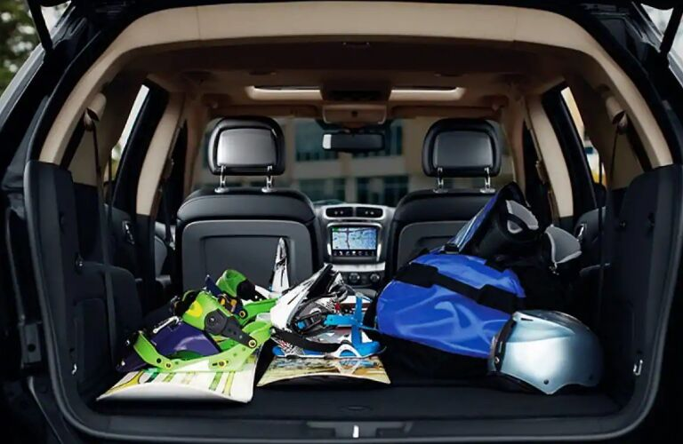 Snowboarding gear in the cargo area of a 2019 Dodge Journey