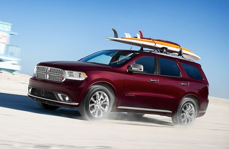 Maroon 2020 Dodge Durango carrying surfboards