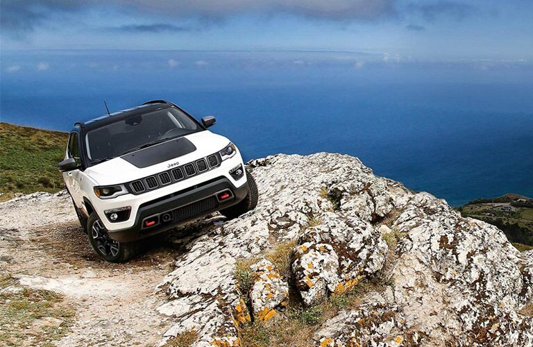 2020 Jeep Compass in white on rock