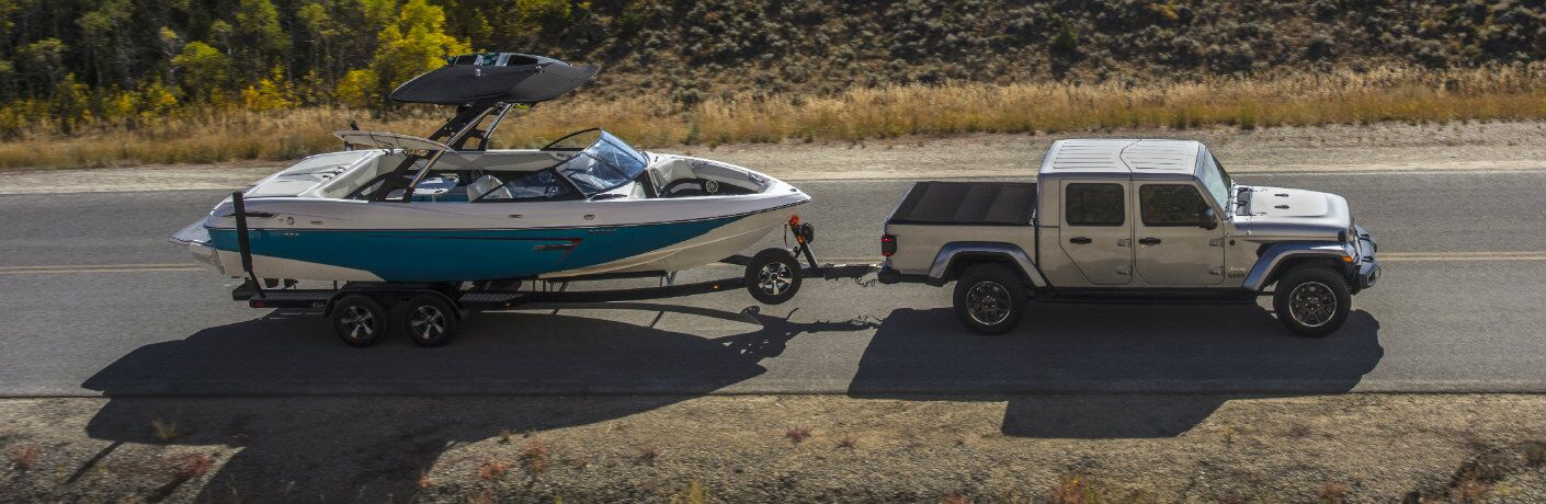 Silver 2020 Jeep Gladiator towing a boat