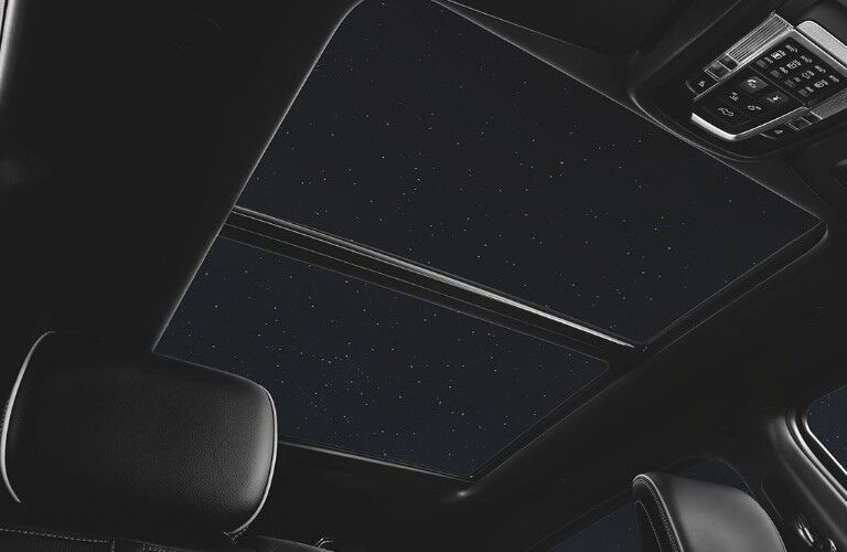 Angle from front row showing the open sunroof inside the 2020 Ram 1500 during night