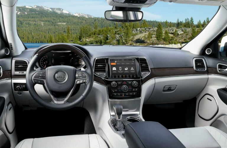 Dashboard and light grey front seats in 2020 Jeep Grand Cherokee