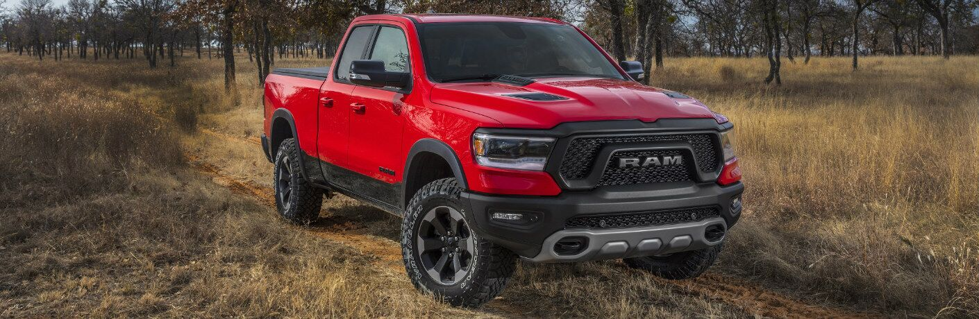 Red 2020 Ram 1500 parked on a grassy field