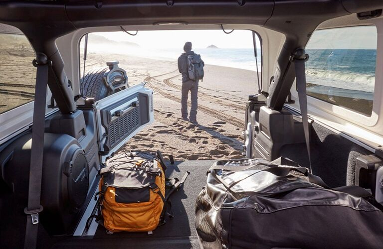 Shot from interior of 2020 Jeep Wrangler showing exterior and trunk of SUV