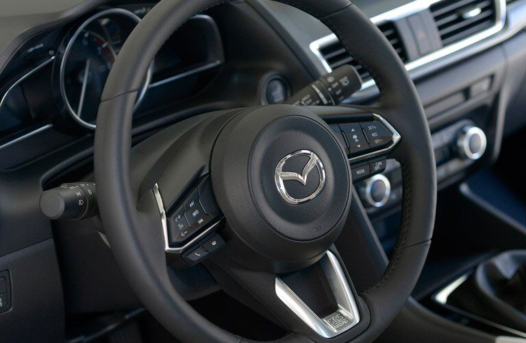 2017 Mazda3 steering wheel closeup