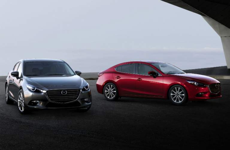 2018 Mazda3 hatchback and sedan next to each other